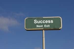 road sign that says success next exit